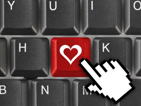 internet love: Computer keyboard with love key - internet concept