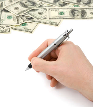 Hand with pen and money isolated on white background photo