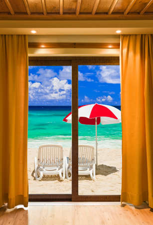 look through window: Hotel room and beach landscape - vacation concept background