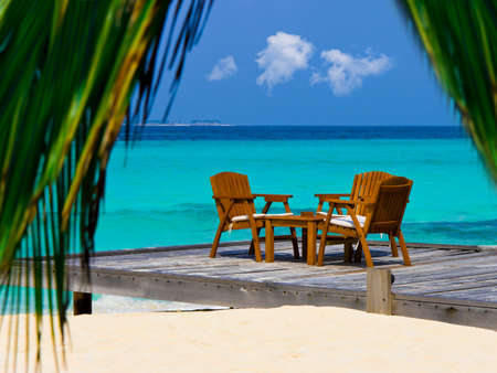 concept hotel: Cafe on the beach, ocean and sky - vacations background
