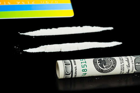 Cocaine, money and plastic card isolated on black background photo