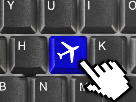 plane tickets: Computer keyboard with Plane key - technology background Stock Photo