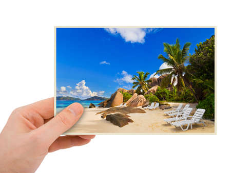Beach photography in hand (my photo) isolated on white background Stock Photo - 9061375