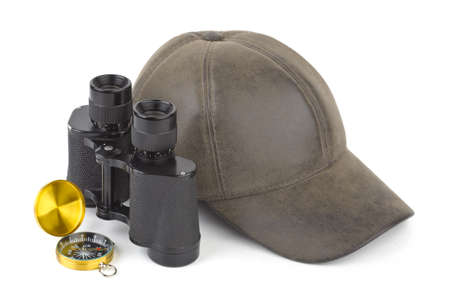 Binoculars, compass and cap - travel concept photo