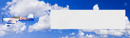 Flying airplane and banner - sky on background photo