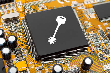Key on computer chip - technology security concept Stock Photo - 9153921