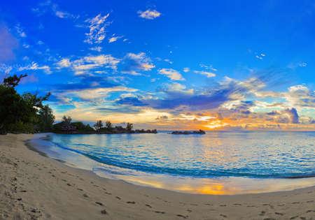 beach sunrise: Tropical beach at sunset - nature background