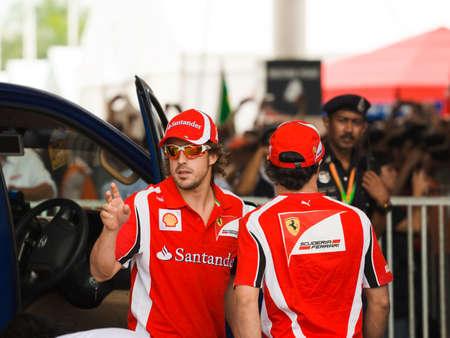 gp: Autograph session at Formula 1 GP, April 10 2011 in Sepang, Malaysia. Fernando Alonso and Felipe Massa, team Scuderia Ferrari