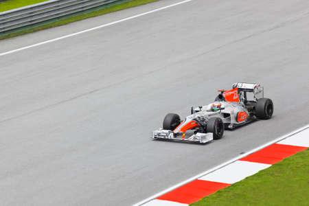 First practice at Formula 1 GP, April 8 2011 in Sepang, Malaysia. Narain Karthikeyan, team Hispania Racing Stock Photo - 9338344