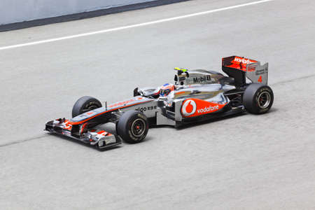 First practice at Formula 1 GP, April 8 2011 in Sepang, Malaysia. Jenson Button, team Vodafone McLaren Mercedes Stock Photo - 9338347