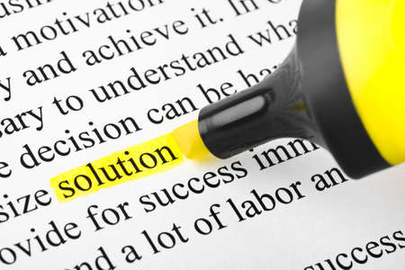 Highlighter and word solution - concept business background photo