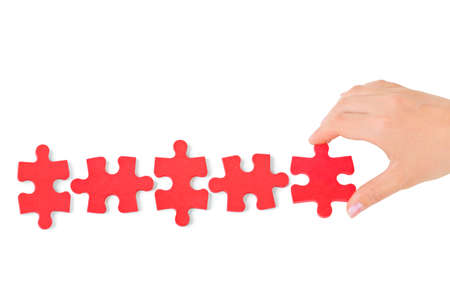 Hand and puzzle isolated on white background Stock Photo - 9359744