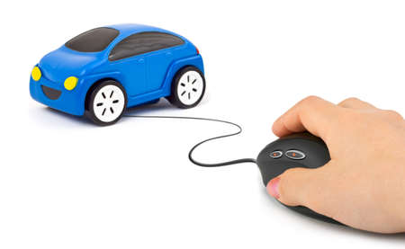 Hand with computer mouse and car isolated on white background Stock Photo