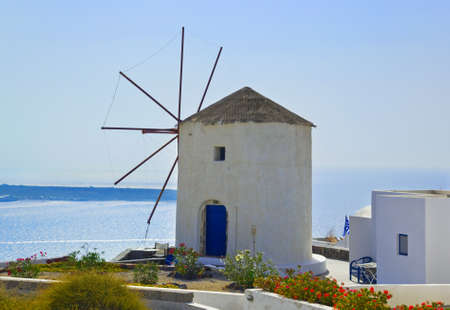 Windmill at Santorini island, Greece - vacation background photo