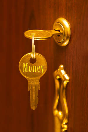 Golden key Money - abstract business concept photo