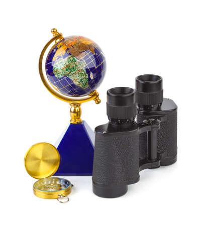 Binoculars, compass and globe - travel concept photo