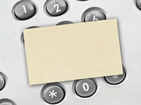 Phone keypad and paper card - business background Stock Photo - 9421623