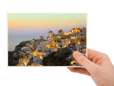 Santorini photography in hand (my photo) isolated on white background photo