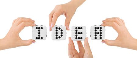 winning business woman: Hands and dices Idea isolated on white background