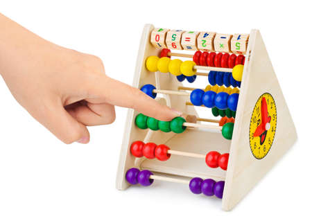 Hand and abacus isolated on white background photo