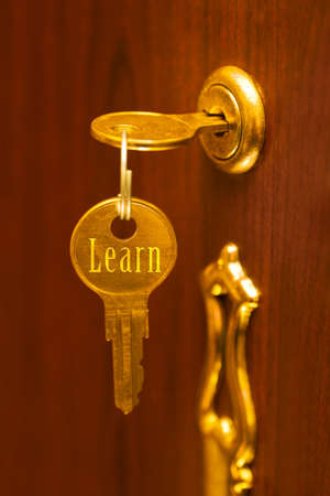 door sign: Golden key Learn - abstract education concept Stock Photo