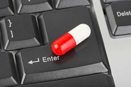 Pill on computer keyboard - concept technology background Stock Photo - 9593910