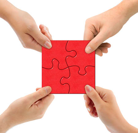 team problems: Hands and puzzle isolated on white background