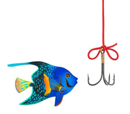 Fishing hook and fish isolated on white background photo