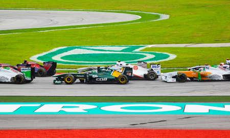 gp: SEPANG, MALAYSIA - APRIL 10: Cars on track at race of Formula 1 GP, April 10 2011, Sepang, Malaysia. First lap.