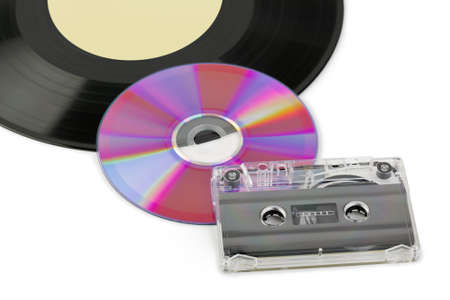 Gramophone disk, cd and cassette isolated on white background photo