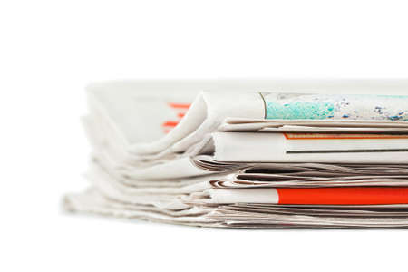 Stack of newspapers isolated on white background Stock Photo - 9640659