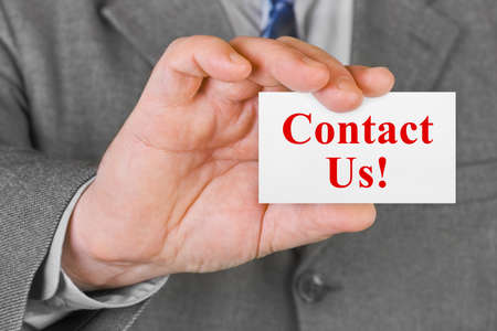 advertise with us: Card Contact us in hand - business background