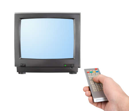 Hand with remote control and tv isolated on white background photo