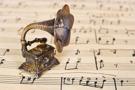 metal music: Gramophone on old sheet music - retro art background
