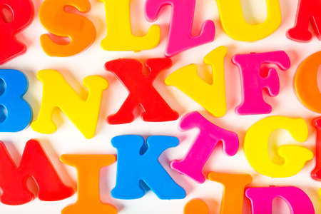 Multicolored toy letters - abstract education background photo