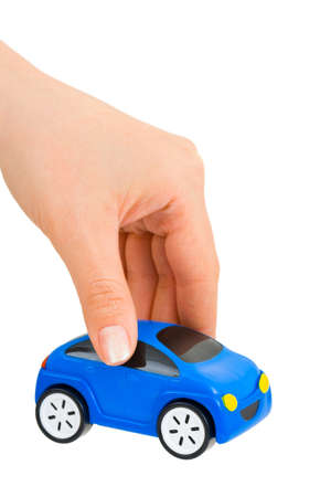 Hand and toy car isolated on white background Stock Photo - 9681646