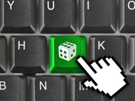 Computer keyboard with dice key - technology background photo