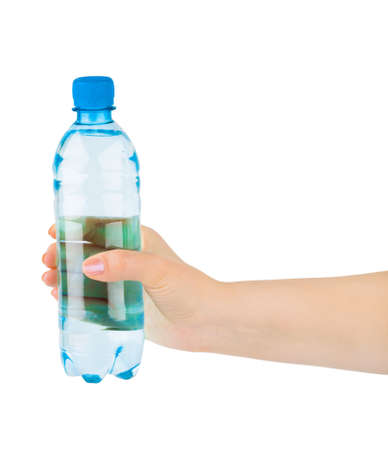 Hand with water bottle isolated on white background photo