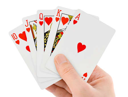 Playing cards in hand isolated on white background photo