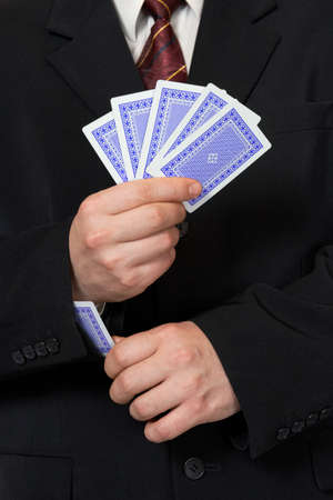 Hands and playing card in sleeve - poker game