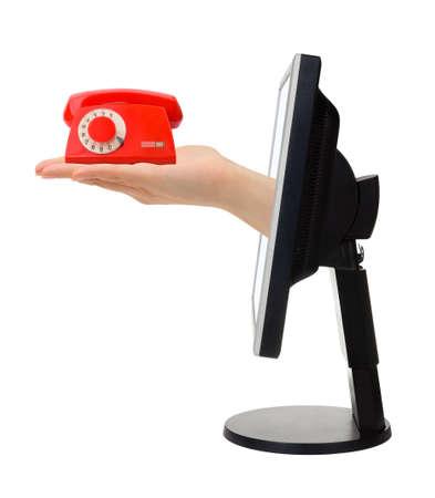 Computer-Bildschirm und Hand mit Telefon isoliert auf wei?em Hintergrund Lizenzfreie Bilder