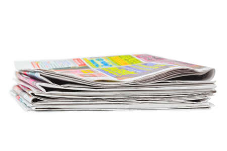 Stack of newspapers isolated on white background photo