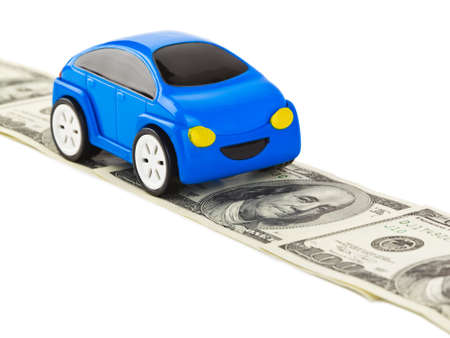 Toy car on money road isolated on white background photo