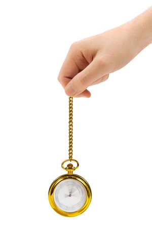 reloj de pendulo: Mano con reloj retro y cadena aisladas sobre fondo blanco Foto de archivo