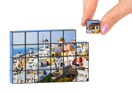 greek islands: Hand and Santorini (my photo) puzzle isolated on white background Stock Photo