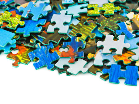 Pieces of puzzle isolated on white background photo