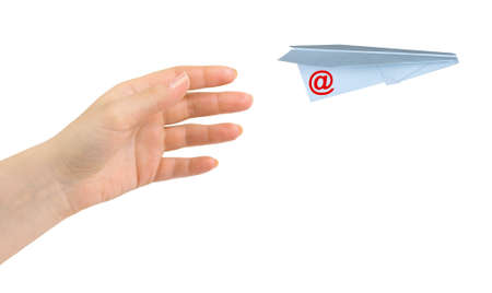 Hand and flying post plane isolated on white background photo