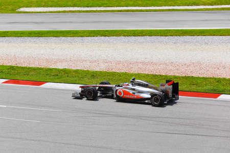SEPANG, MALAYSIA - APRIL 8: Jenson Button (team McLaren Mercedes) at first practice on Formula 1 GP, April 8 2011, Sepang, Malaysia