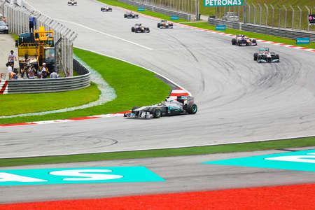 gp: SEPANG, MALAYSIA - APRIL 10: Cars on track at race of Formula 1 GP, April 10 2011, Sepang, Malaysia