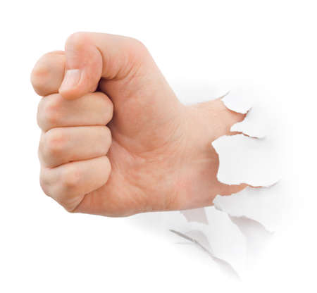 breaking through: Fist punching paper isolated on white background Stock Photo